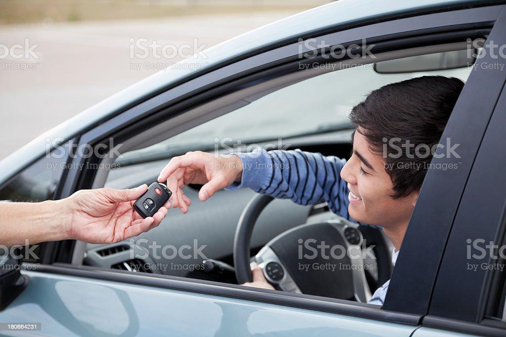 Teen driver getting car keys royalty-free stock photo