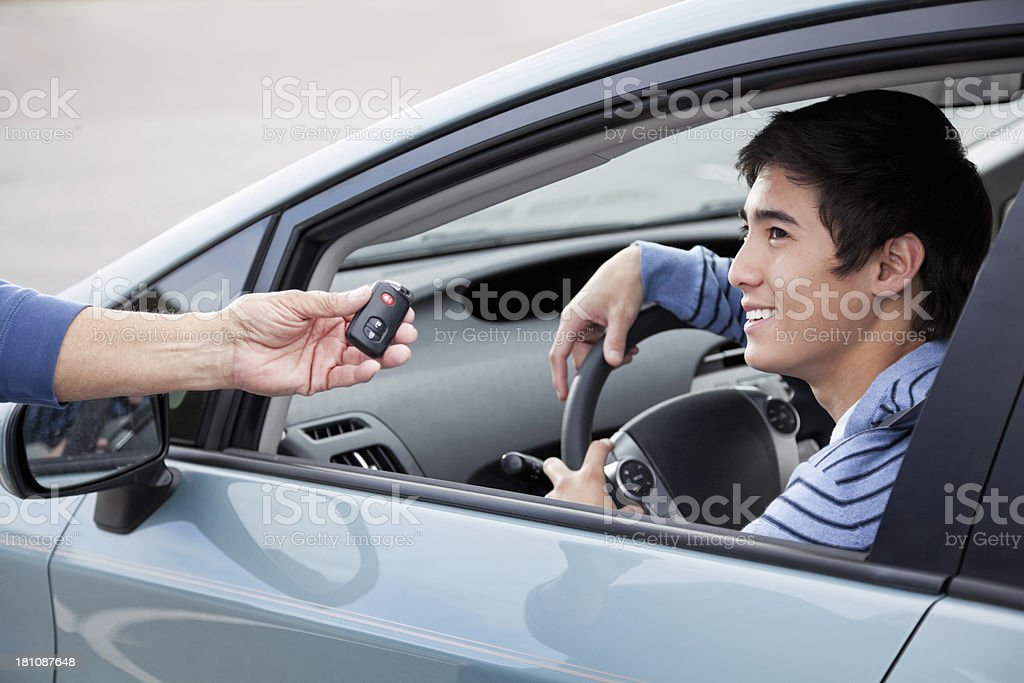 Teen driver getting keys royalty-free stock photo