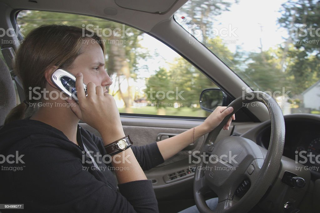 Teen Driver Talks on Cell Phone royalty-free stock photo