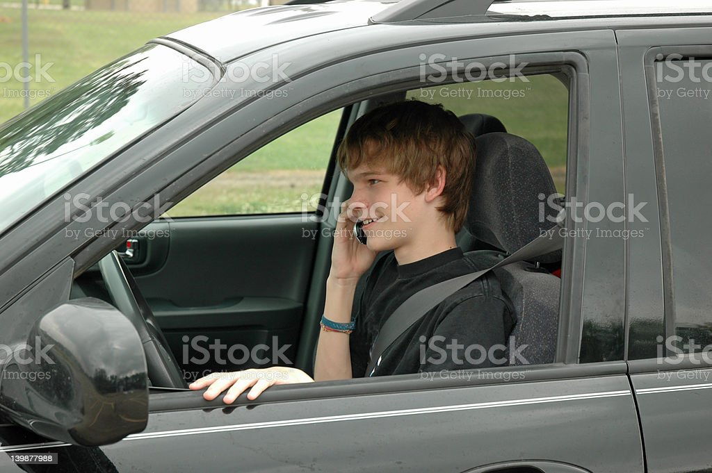 Teen Driver with a Cell Phone stock photo