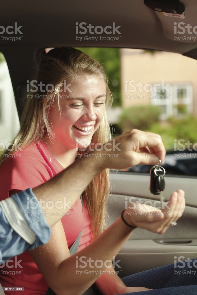 Teen Driver with Her First Car Vertical royalty-free stock photo