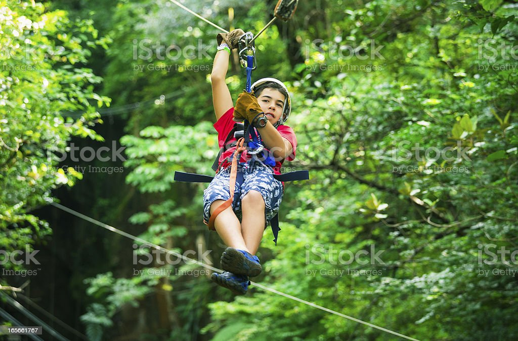 teen during a Canopy Tour in Costa Rica royalty-free stock photo