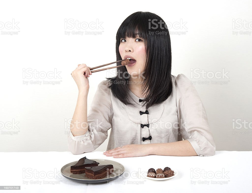 Teen eating chocolate stock photo
