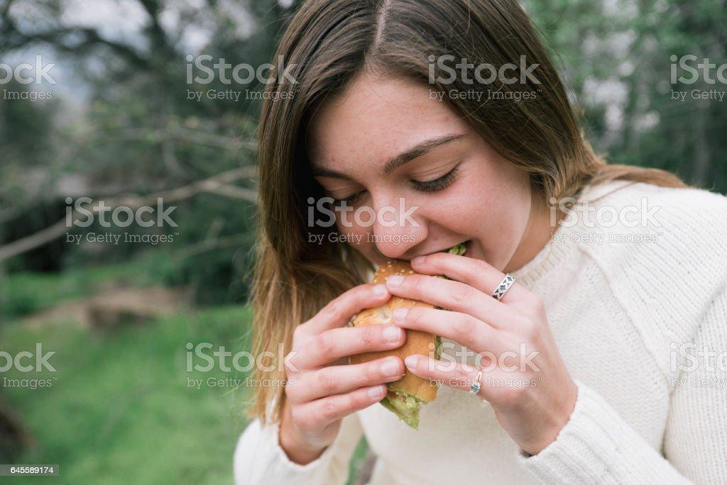 Teen Eating Sandwich stock photo