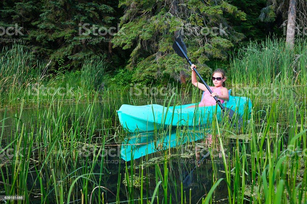 Teen exploring a wild river stock photo