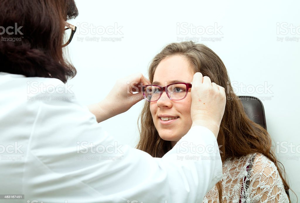 Teen eye exam stock photo
