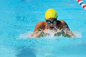Teen Female Breaststroke Swimmer Race in Pool