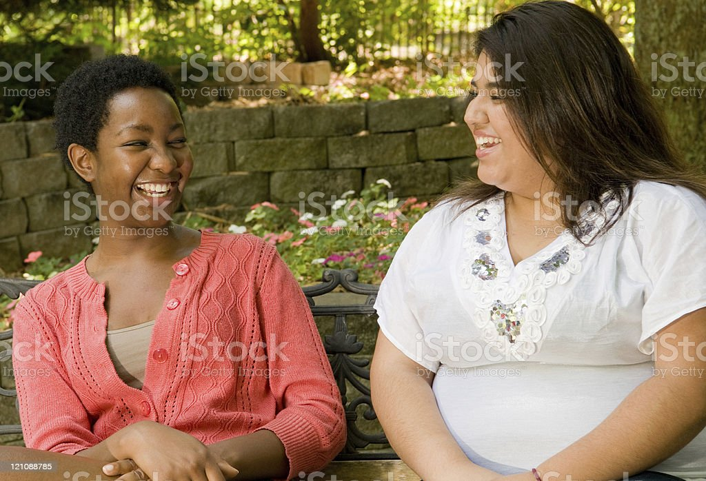 Teen friends enjoying a laugh stock photo