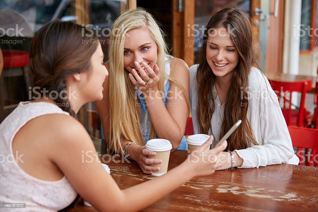 teen friends out for coffee stock photo