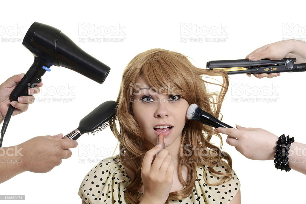 Teen girl getting a makeover royalty-free stock photo