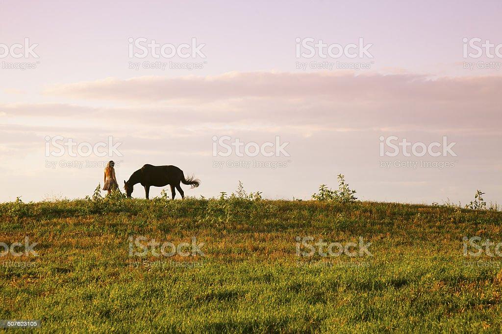 Teen girl grazing her horse royalty-free stock photo