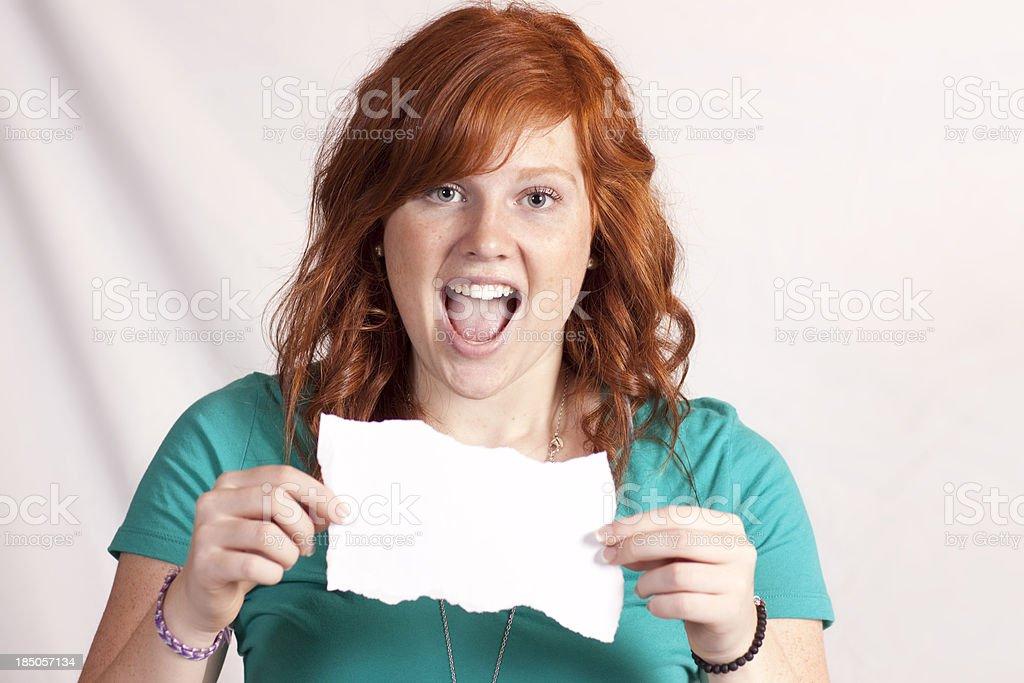 Teen Girl Holding White Paper stock photo