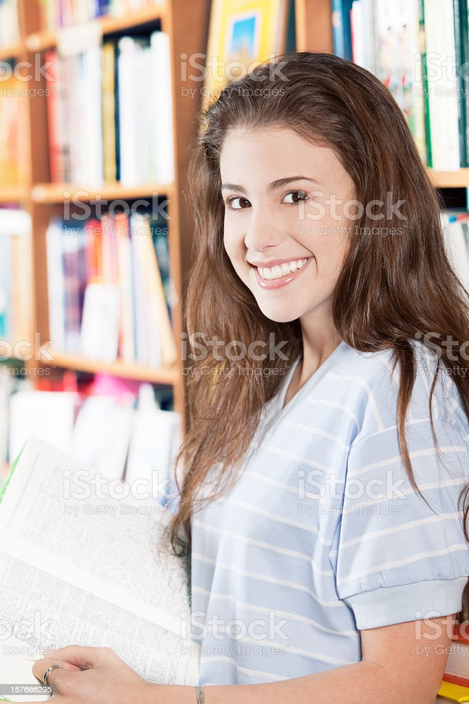 Teen Girl in Library royalty-free stock photo