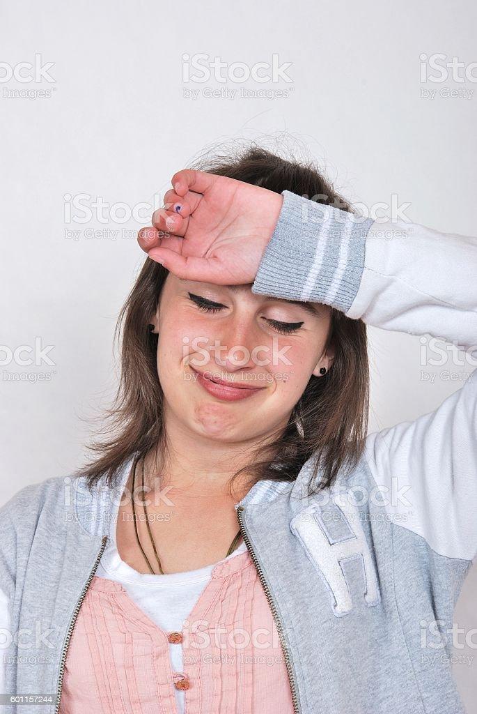 Teen girl looking discouraged stock photo