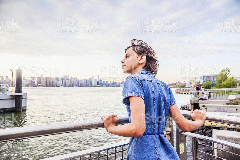 Teen girl looking to the Manhattan skyline royalty-free stock photo