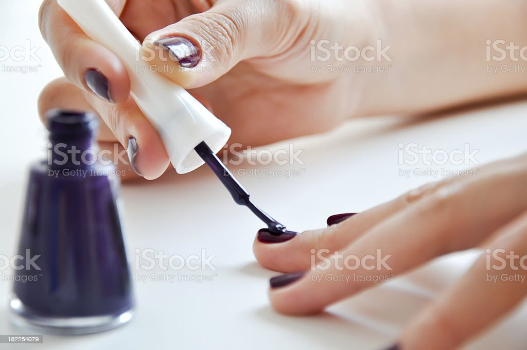 teen girl making manicure stock photo