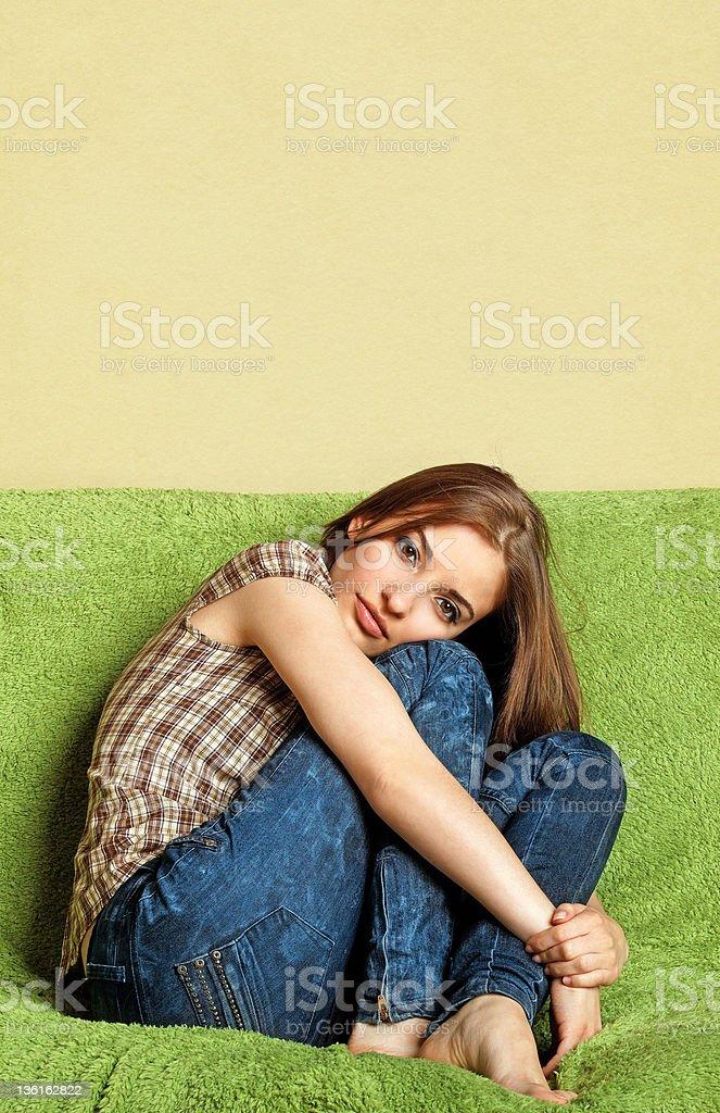 Teen girl on sofa stock photo