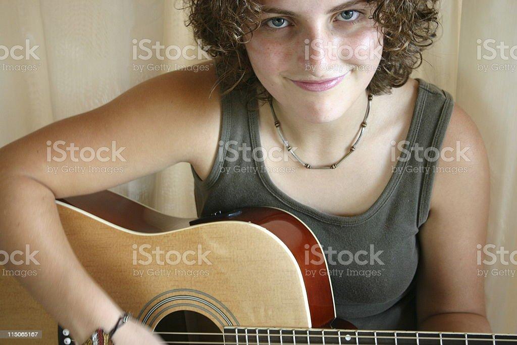 Teen girl playing guitar royalty-free stock photo