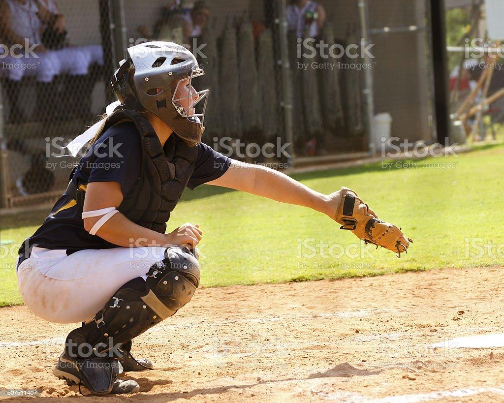 Teen girl playing softball in organized game stock photo