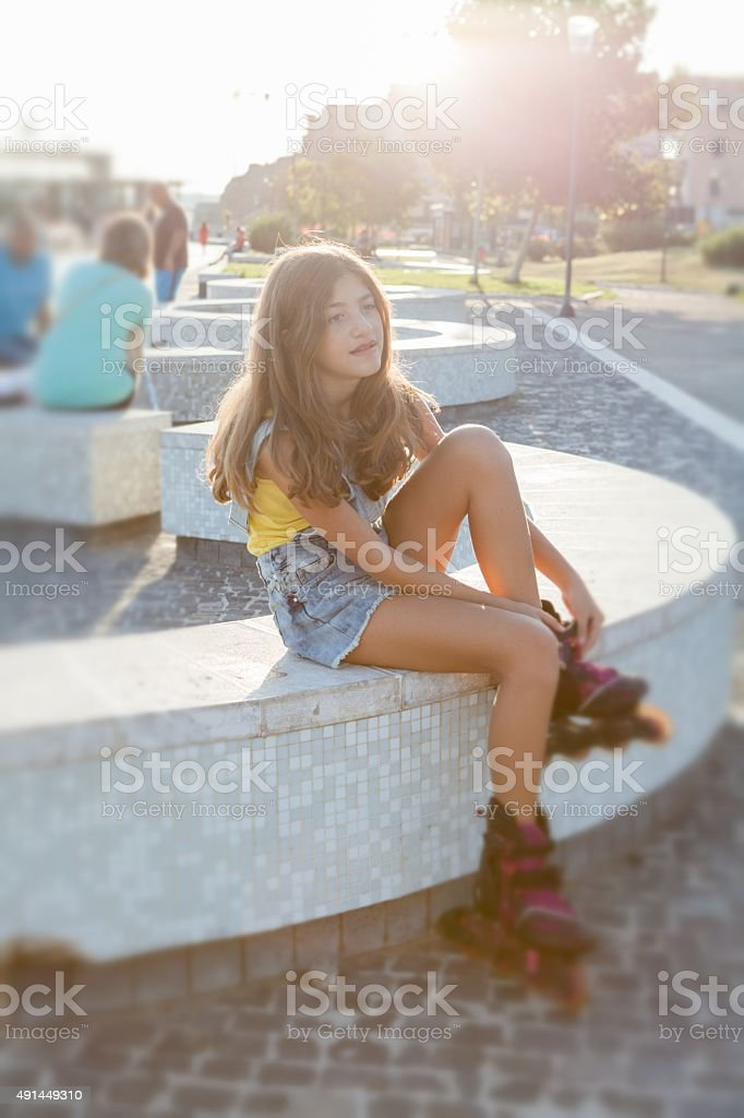 Teen Girl portrait  with Roller Skate at park stock photo
