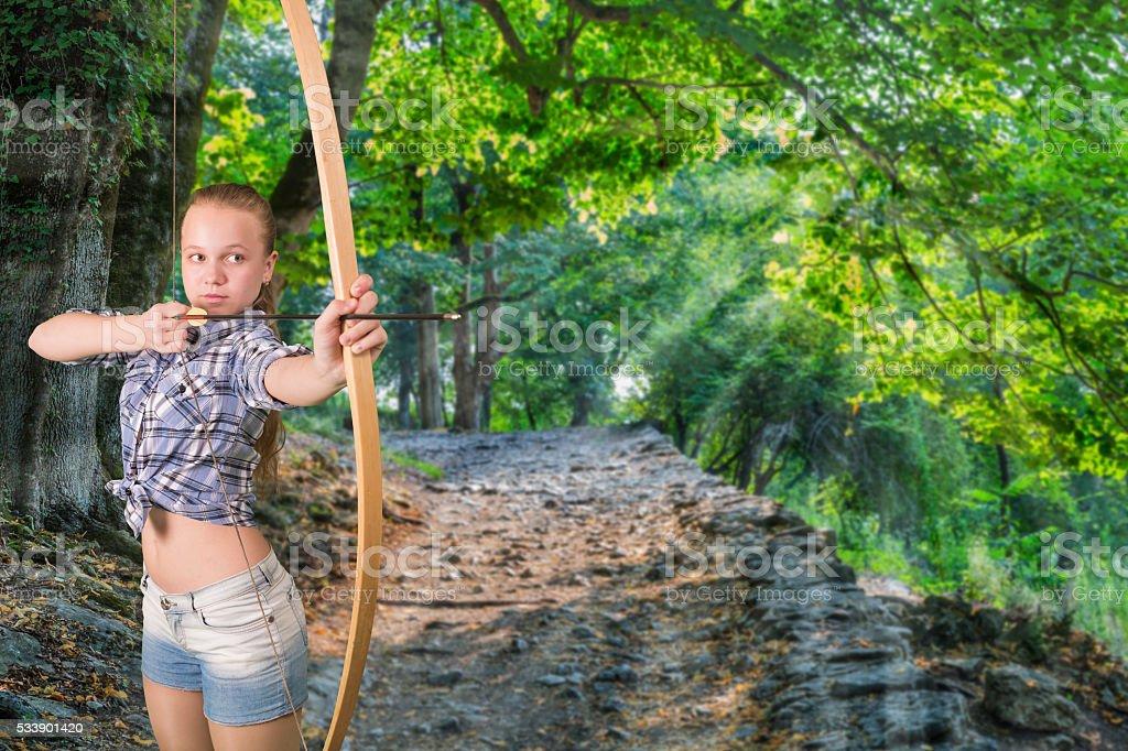 Teen girl practicing archery stock photo