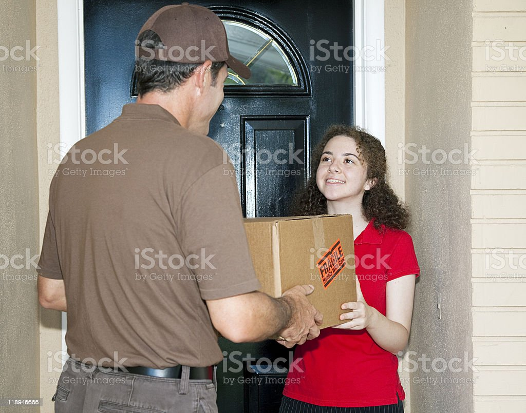 Teen Girl Receives Delivery royalty-free stock photo