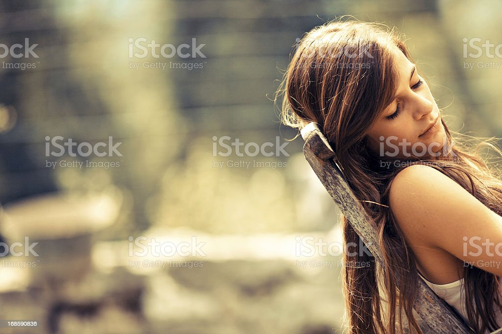Teen girl resting outdoors royalty-free stock photo