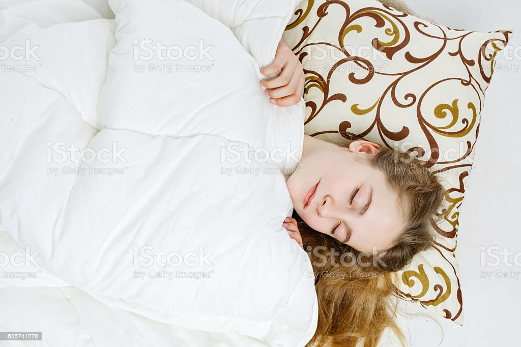 Teen girl sleeping stock photo