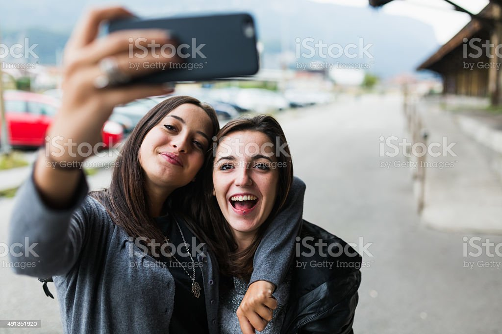 Teen girl taking a selfie stock photo