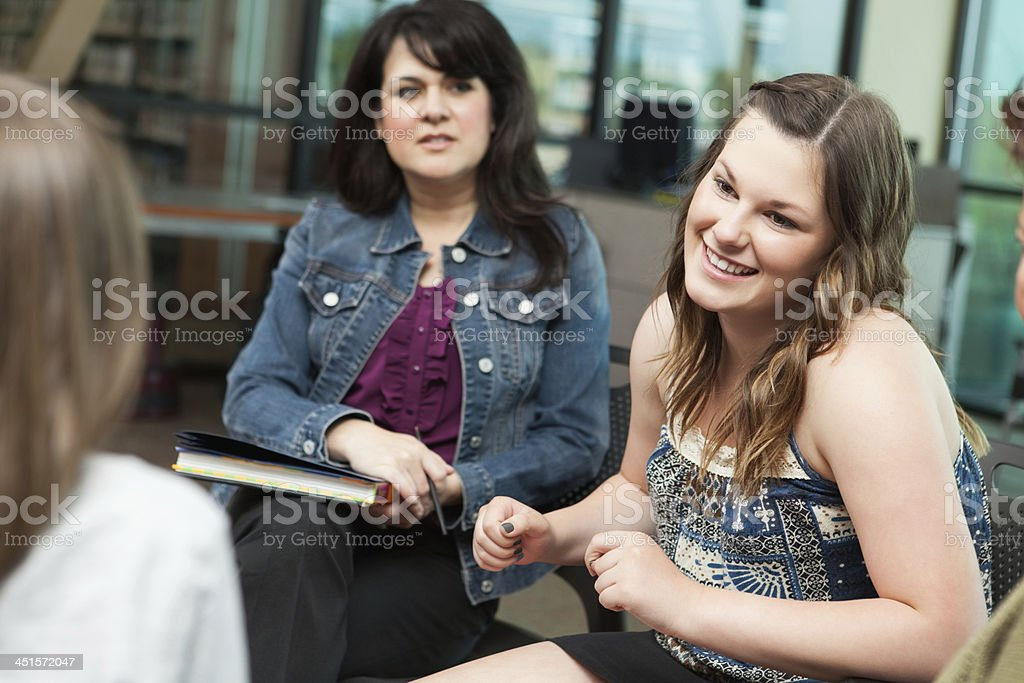 Teen girl talking during group counseling session stock photo