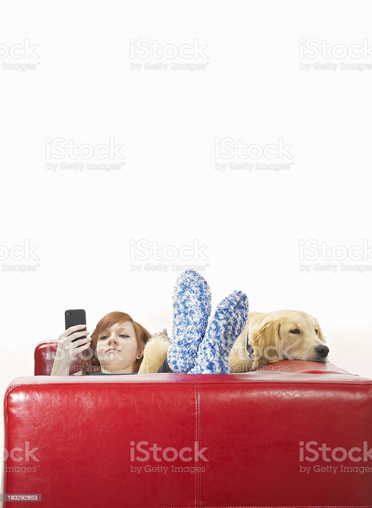 Teen girl texting on the couch royalty-free stock photo