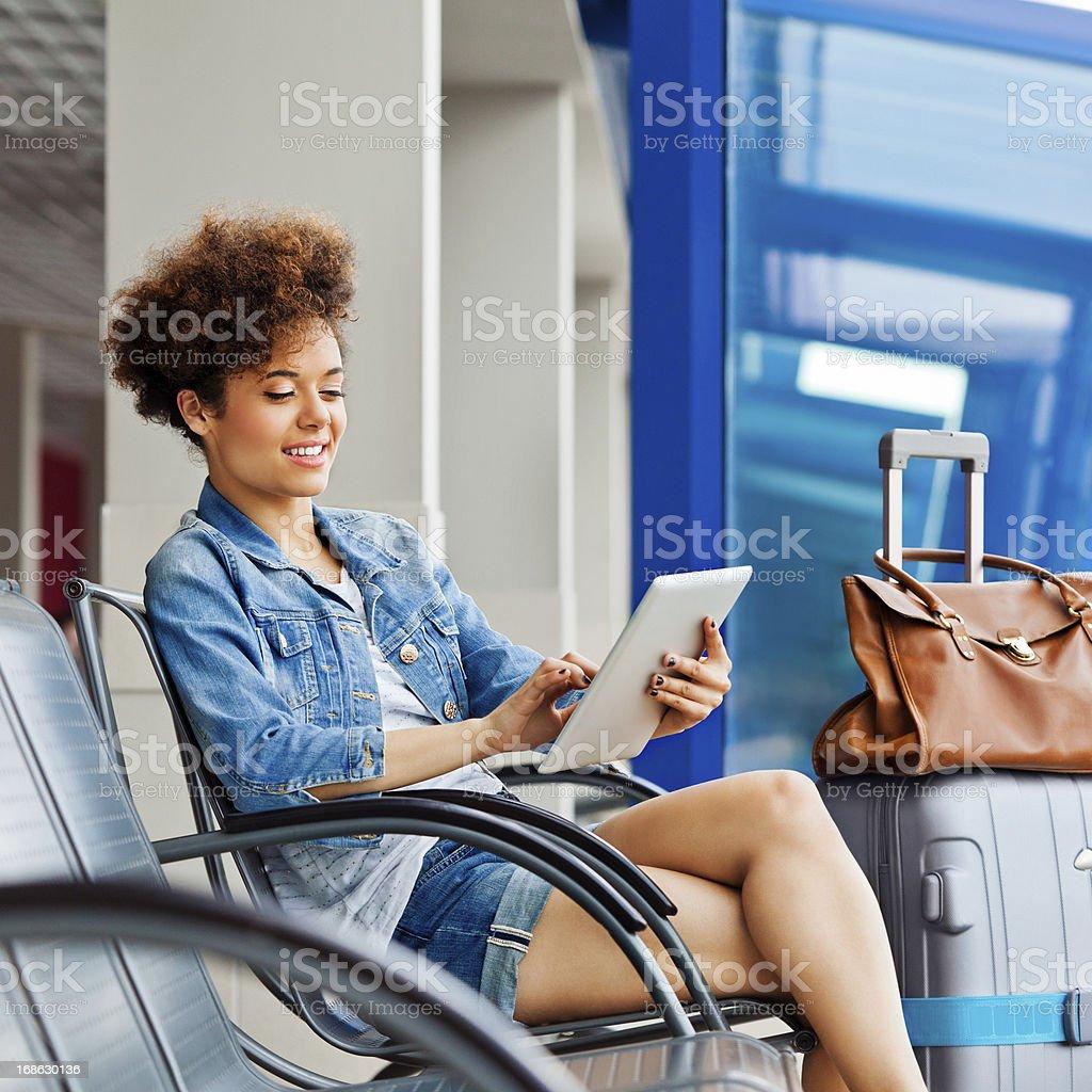 Teen girl waiting for flight royalty-free stock photo