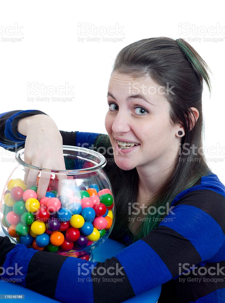 Teen Girl With Dental Braces and Chewing Gum Candy. royalty-free stock photo