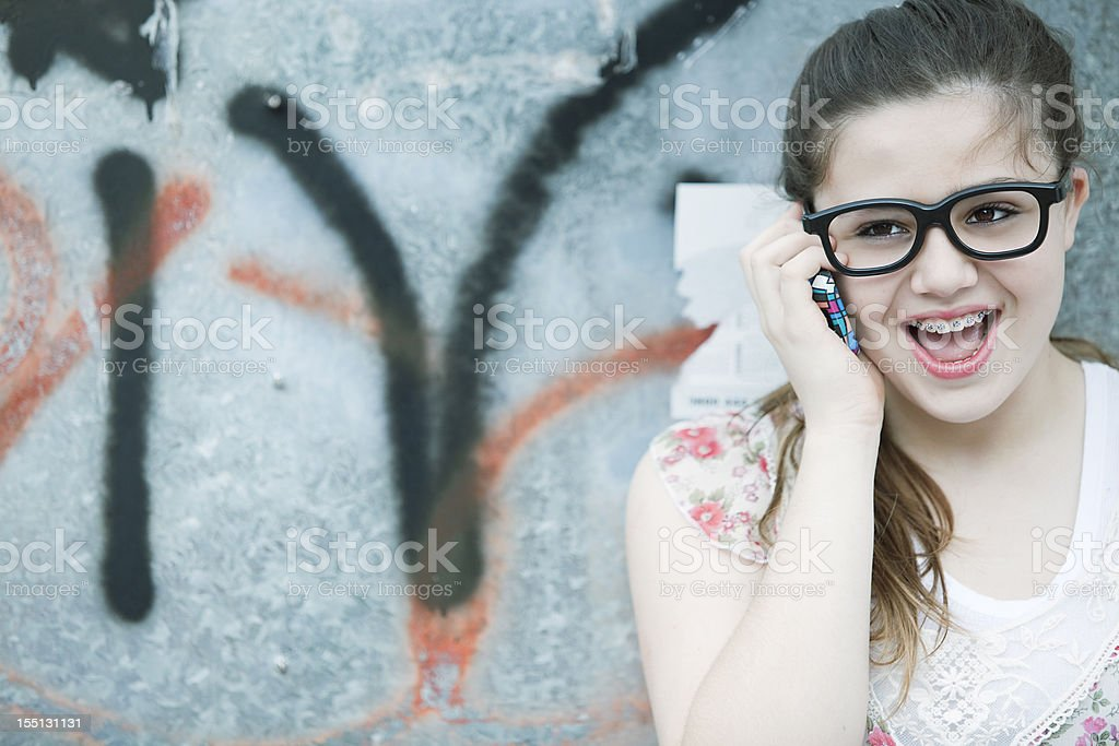 Teen Girl with Glasses on the Phone royalty-free stock photo