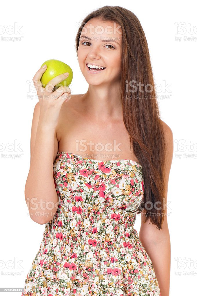 Teen girl with green apple stock photo
