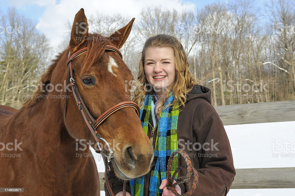 Teen Girl With Horse, Outdoors Winter Snow royalty-free stock photo