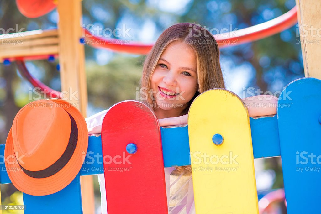 teen girl with long blond hair in municipal park stock photo