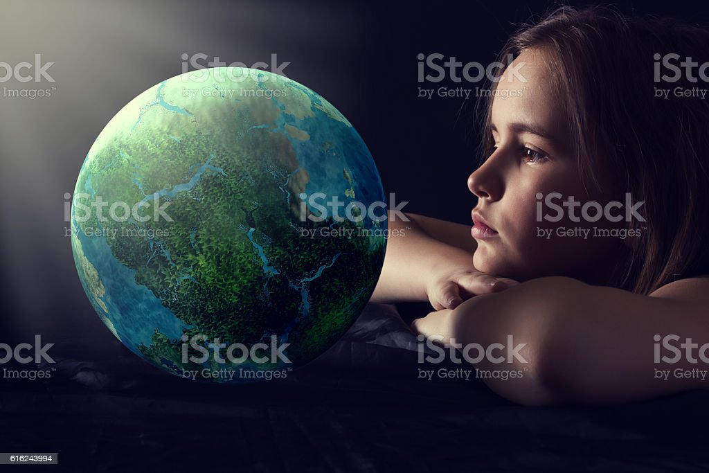 Teen girl with planet earth. royalty-free stock photo