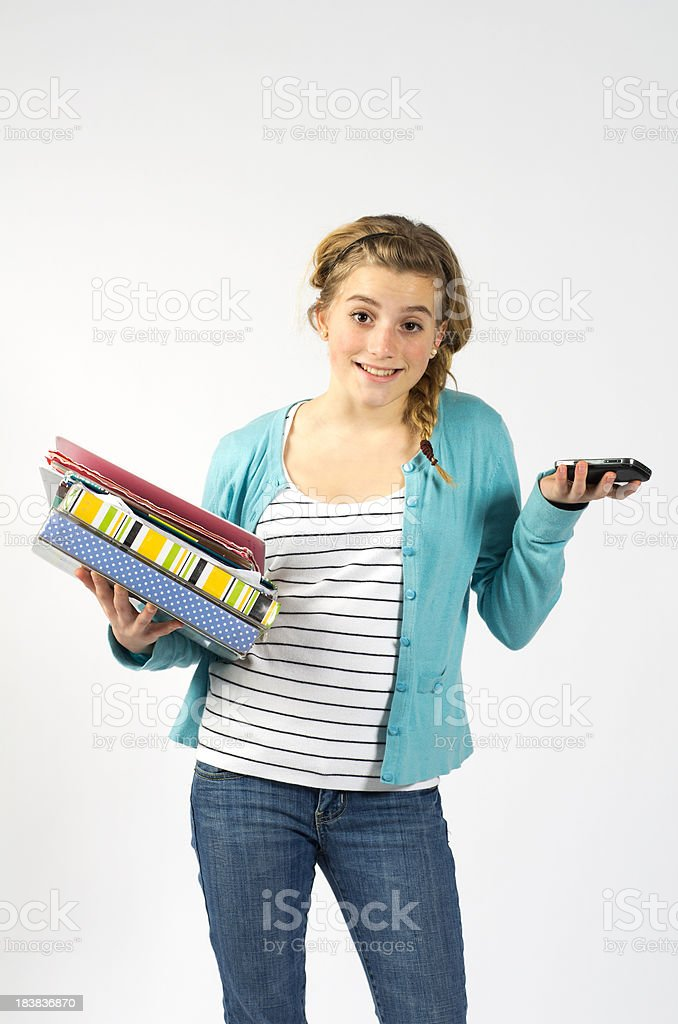 Teen Girl with Smart Phone and Homework royalty-free stock photo