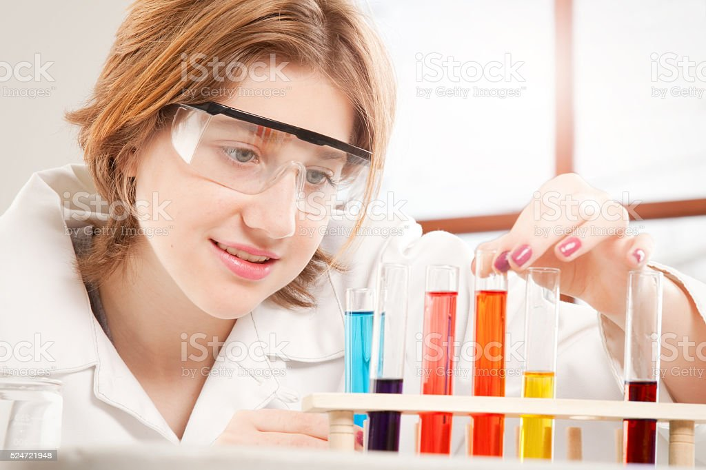 Teen Girl With Test Tubes Close Up stock photo