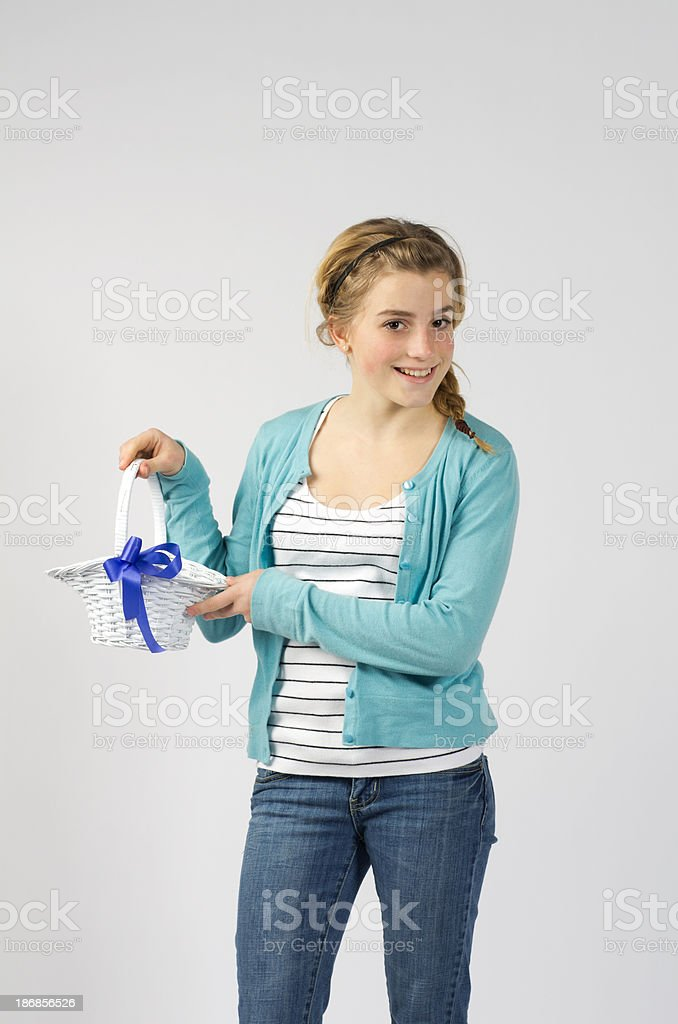 Teen Girl with White Wicker Basket stock photo