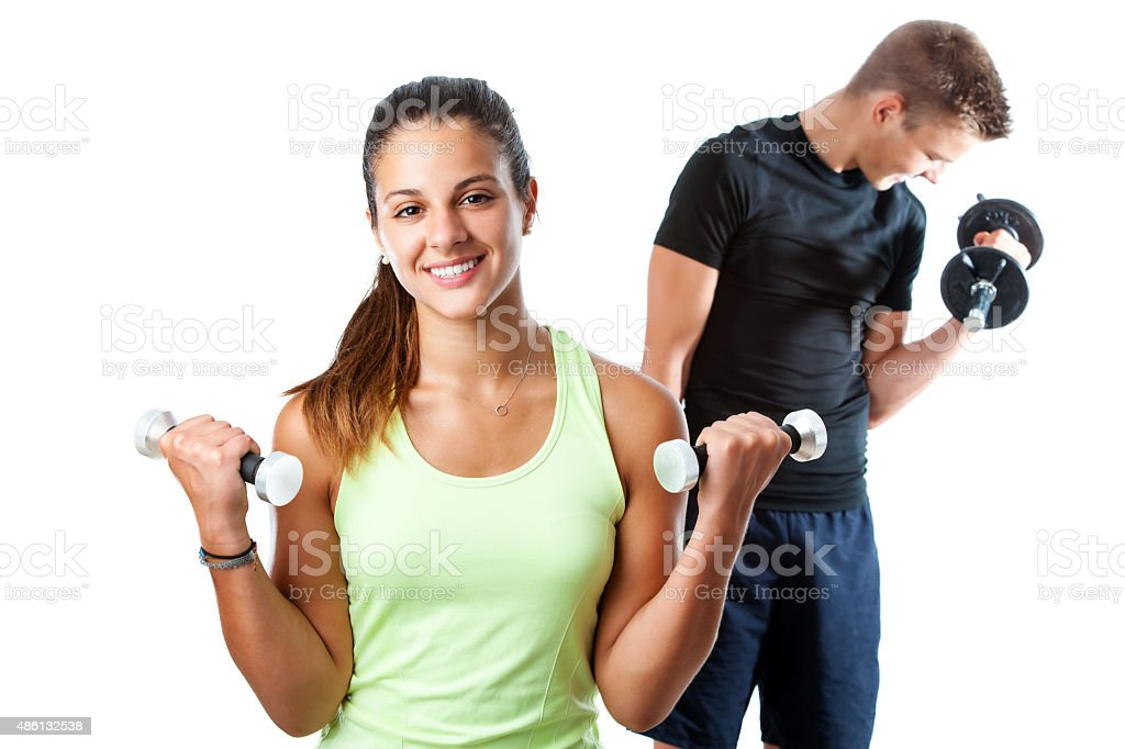 Teen girl working out with boy in background. stock photo