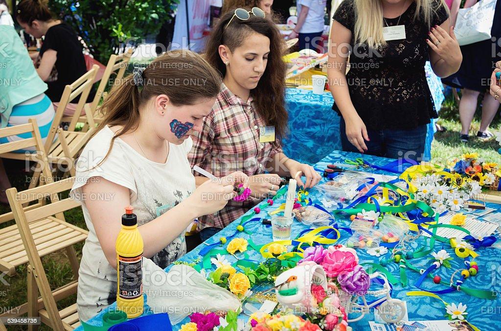 Teen girls at handicraft workshop stock photo