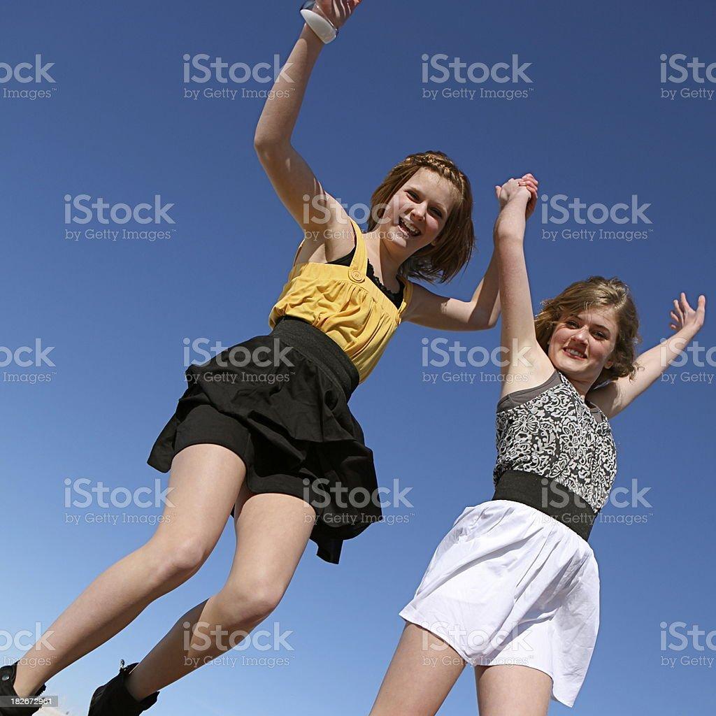 Teen Girls Jumping for Joy royalty-free stock photo