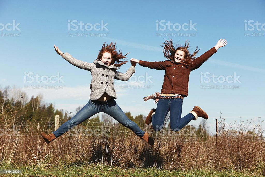 Teen Girls Jumping Outside royalty-free stock photo