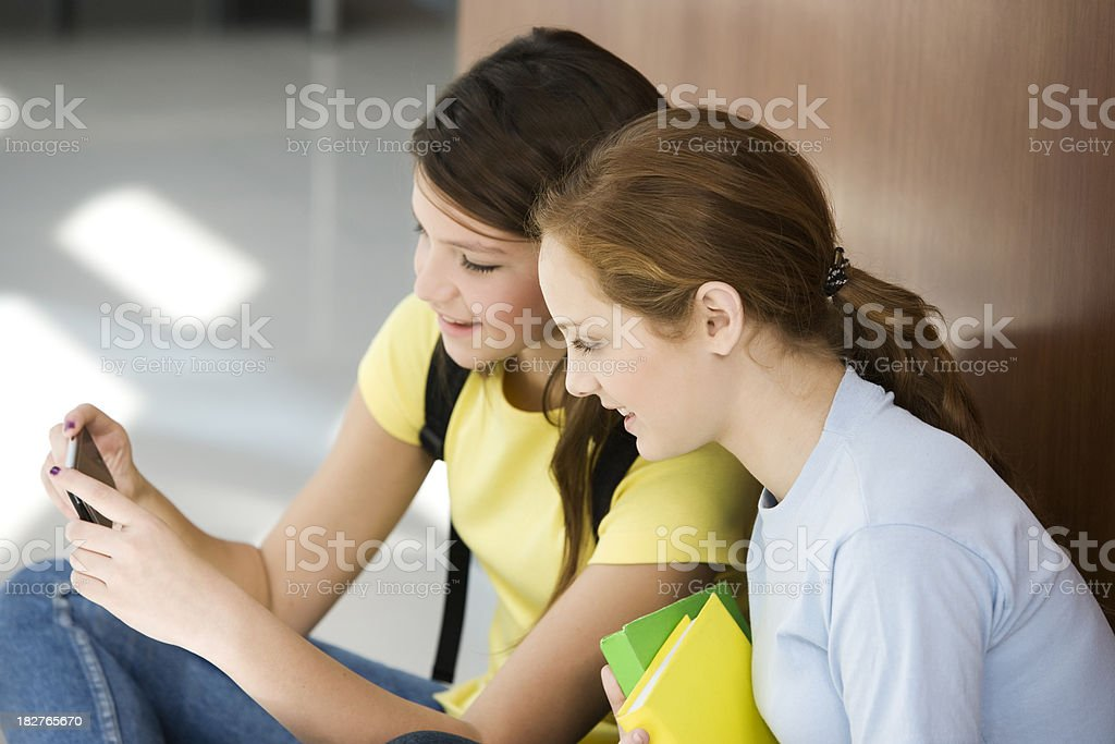Teen Girls Playing with Cel Phone royalty-free stock photo