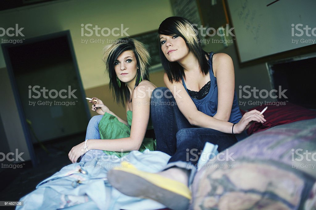Teen Girls Smoking  in Abandoned Building royalty-free stock photo