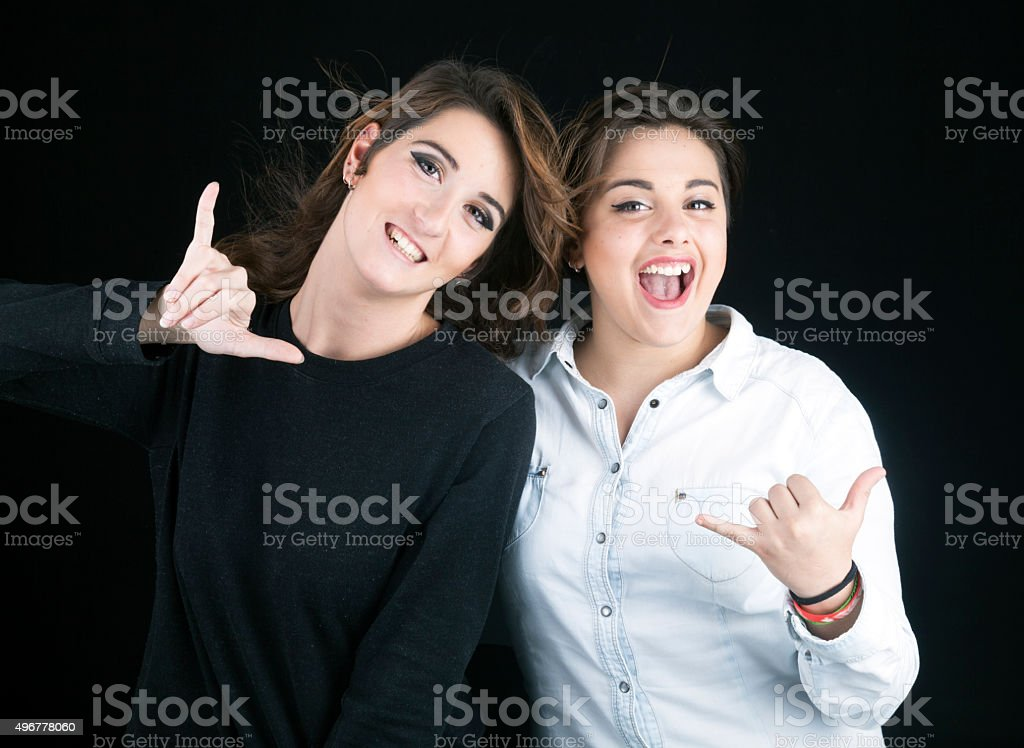 Teen girs doing the shaka sign stock photo