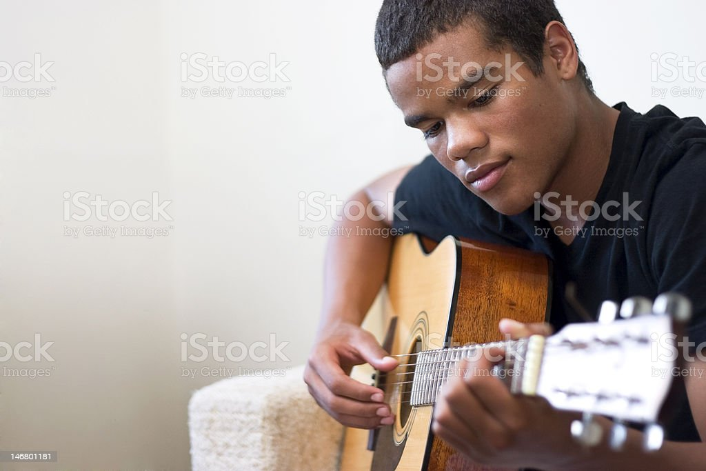 Teen Guitarist stock photo
