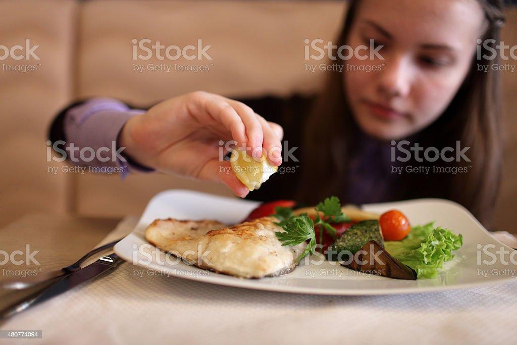 Teen has lunch stock photo